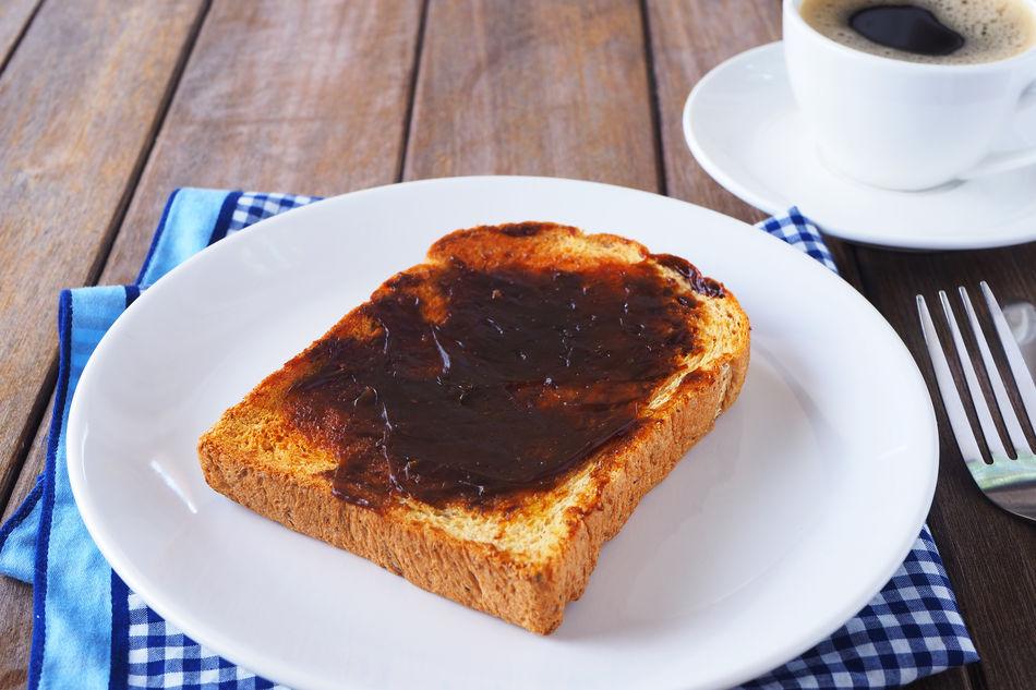 Vegemite spread onto toast