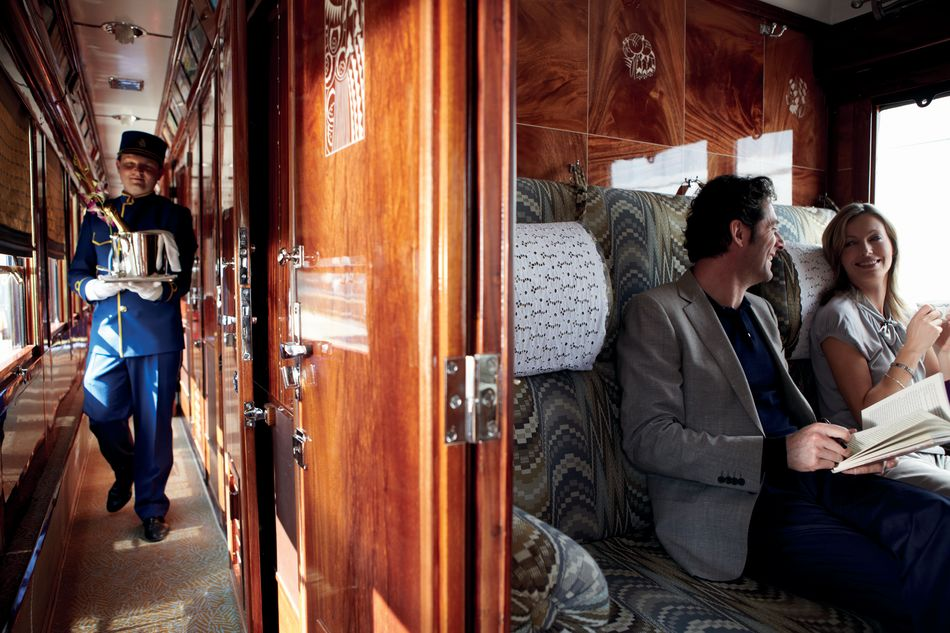 A cabin in the Venice Simplon-Orient-Express with private service by a personal steward