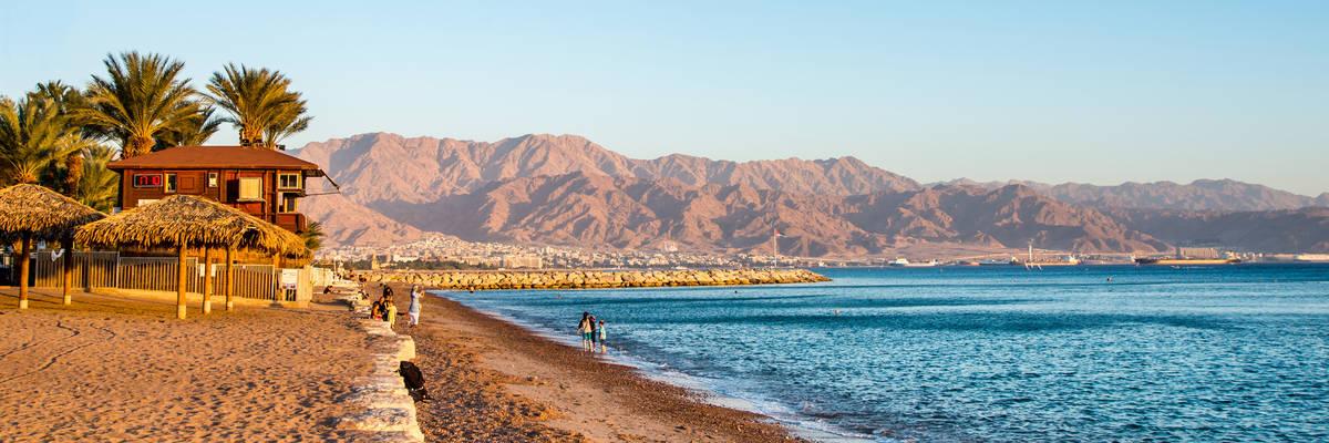 View of Eilat beach, Israel over Aqaba city, Jordan