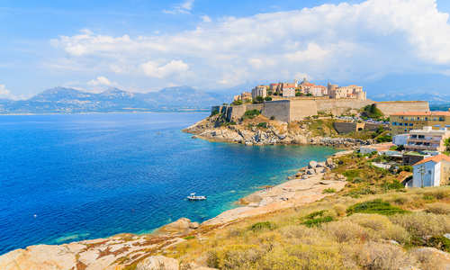 View of citadel with houses in Calvi bay, Corsica island, France