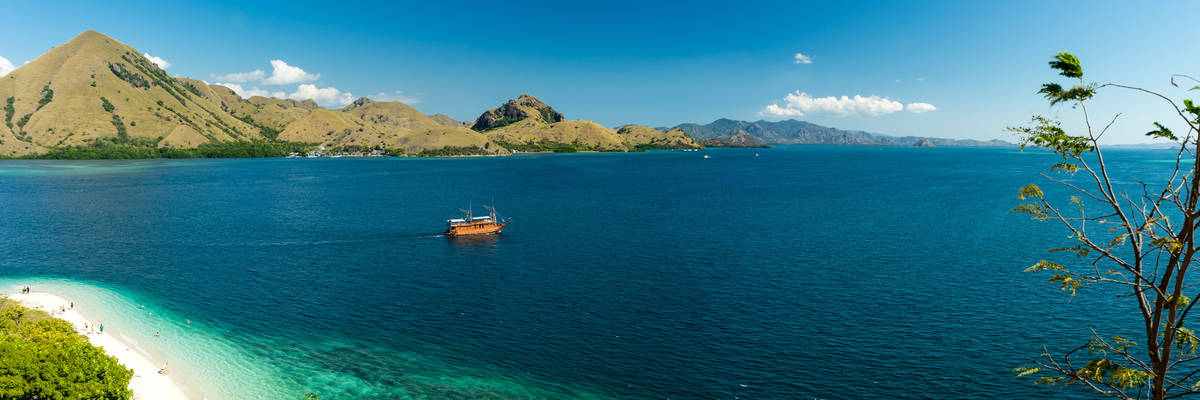 View over white sand beach and coral bay at Komodo, Flores Indonesia
