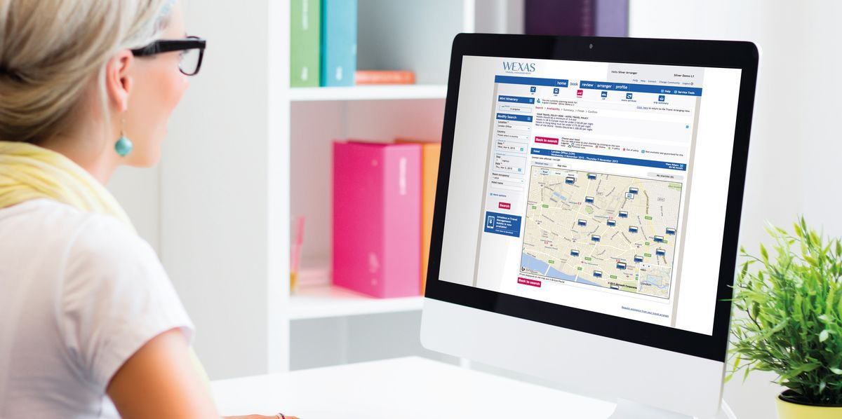 Woman using Wexas Travel Management's Online Booking Tool