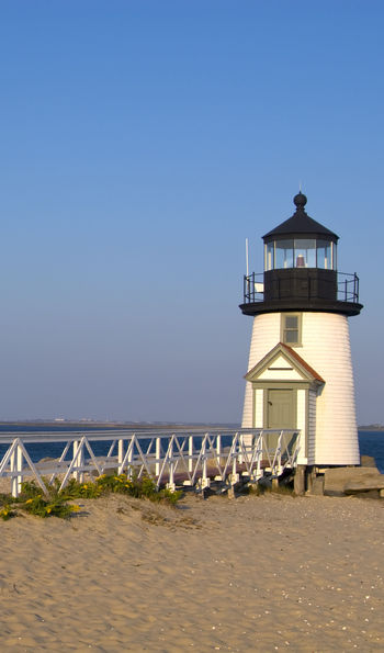 Walkway leads to Brant Point lighthouse, a famous beacon on Nantucket Island in Massachusetts