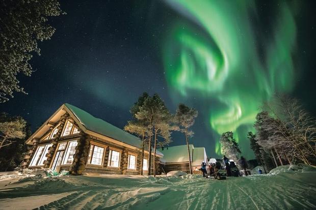Wilderness Hotel Nangu under the Northern Lights in Finnish Lapland