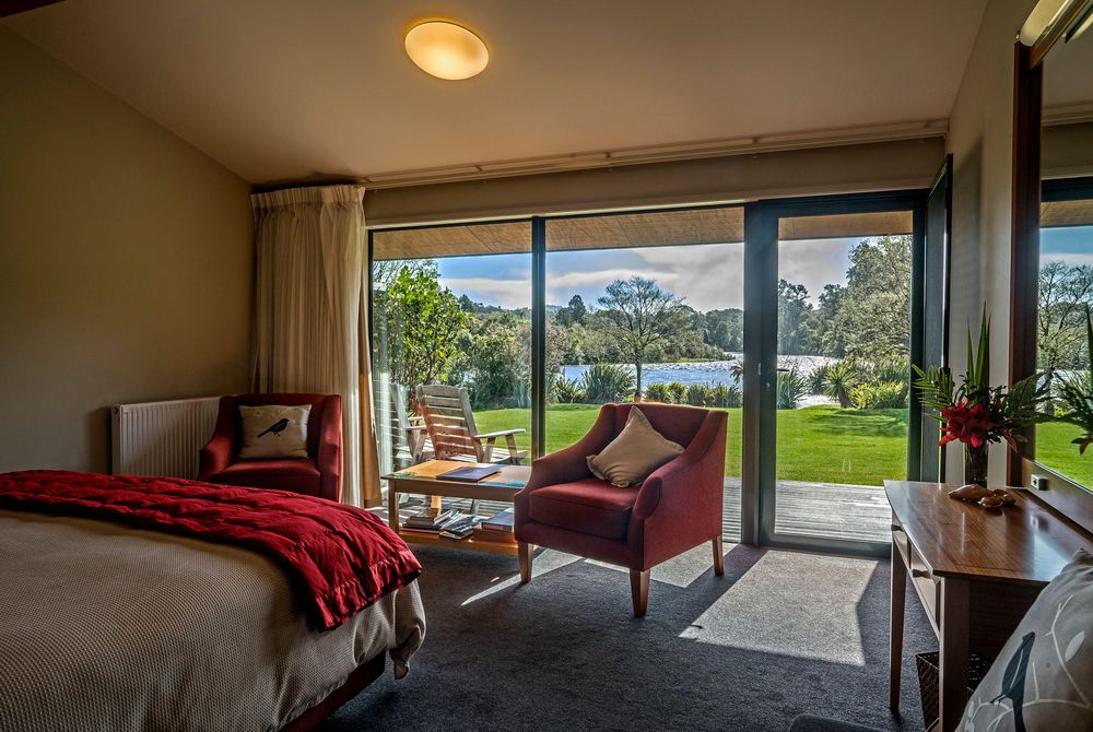 Wilderness Lodge riverview room with outdoor view, New Zealand