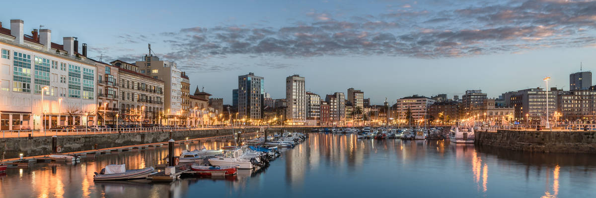 Yachts and pier in leisure port on maritime fishing district of Gijon, Spain