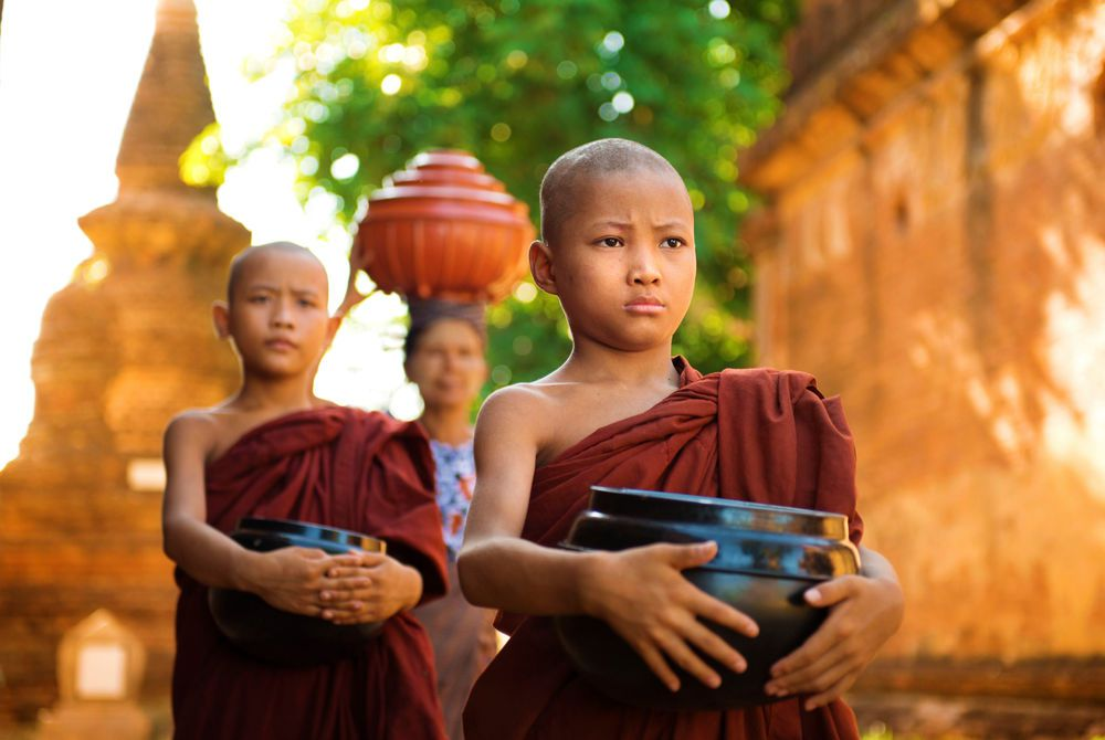 Young monks collecting alms, Bagan