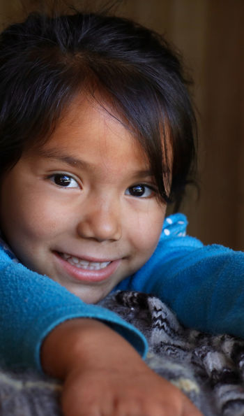 Young Chilean girl looking into camera