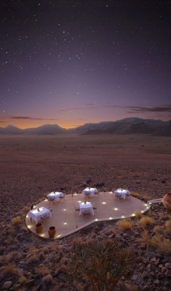 and Beyond Sossusvlei Desert Lodge dining under the stars