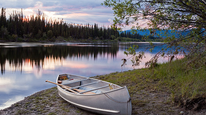 A canoe on the banks of the Teslin River, Yukon