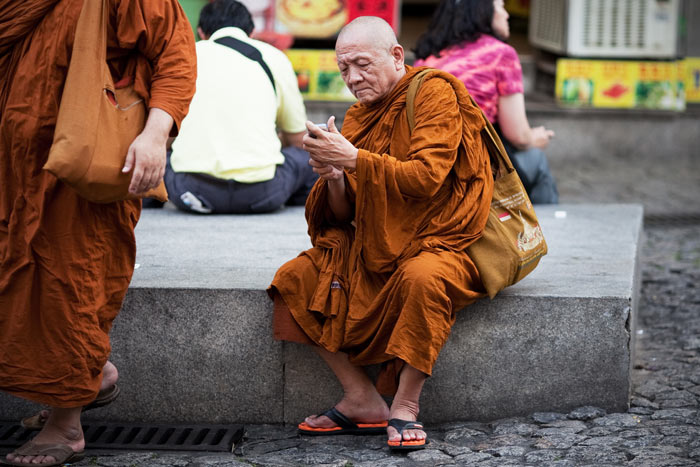 A monk checks his phone, Macau