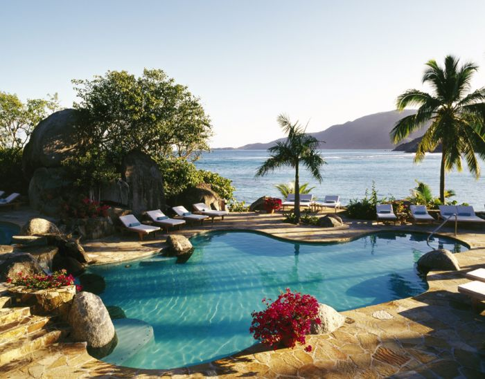 Poolside at Rosewood Little Dix Bay
