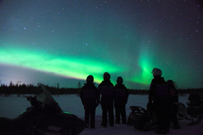 Northern Lights hunting by snowmobile