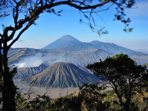 The active volcanoes of Bromo (left) and Semeru (back), and dormant Batok, viewed from Pananjakan