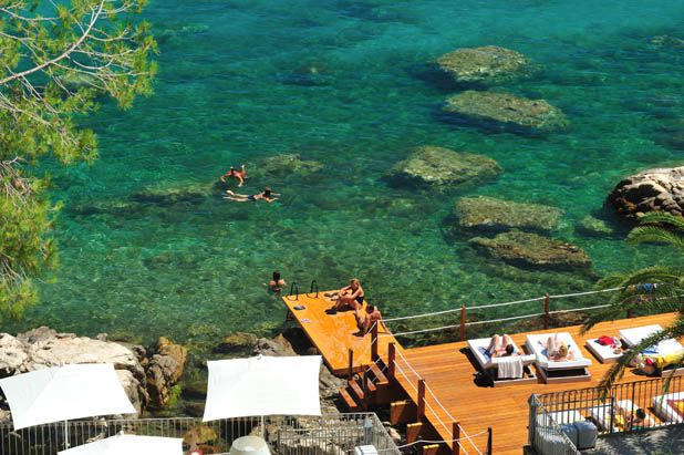 Sunbathing and swimming at Le Calette, Sicily