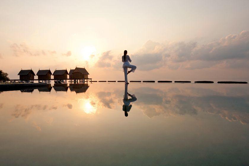 Yoga by the pool - Constance Moofushi, Maldives