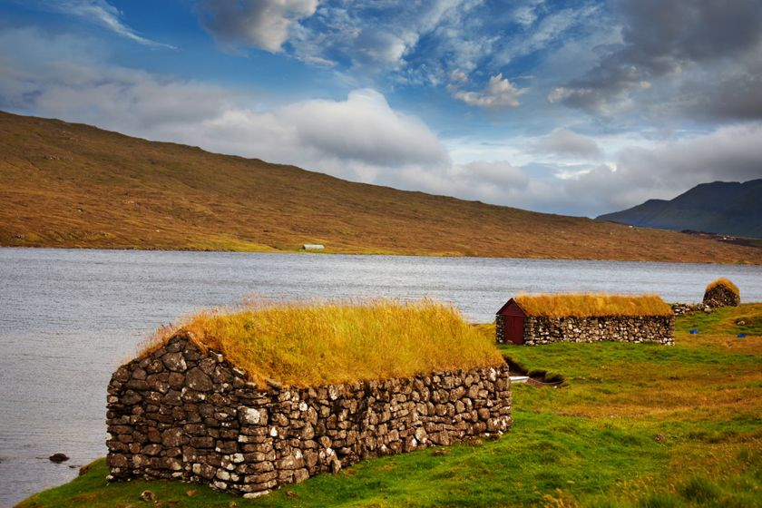 Remote grass-roof farm buildings in Faroe Islands